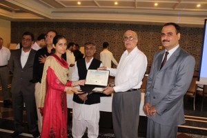 Dr. Shujat Ali presenting certificate to a participant of training