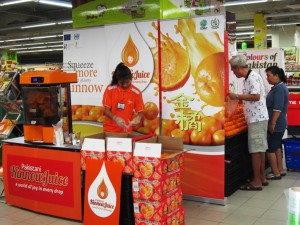 Customers purchasing Kinnow after tasting the juice at the Sheng Siong Supermarket