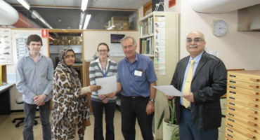 Syeda Mahmoona Kazmi, (TM Seed Germination lab at FSC&RD) receiving his certificate from RS Smith in the presence of Rachel Harvey & Cohen Davie of the Seed Testing Lab and Programme Officer (TRTA II) at Launceston, Tasmania