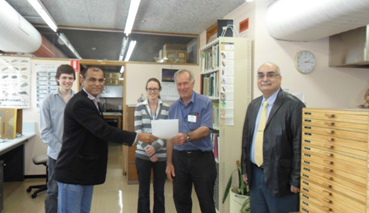 Nazar Iqbal, Deputy QM FSC&RD receiving his certificate from RS Smith