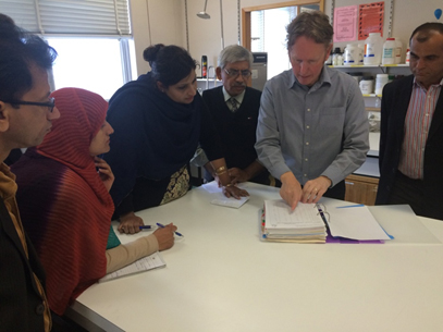 Peter Cross (Team Leader Plant Pathology Lab) explaining to the FSCR&RD staff (TMs Plant Health) the record keeping procedures being practiced at the NATA accredited Plant Health Lab in Hobart Tasmania