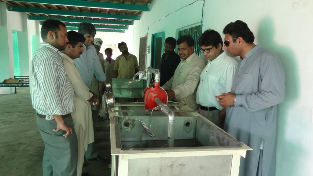 Mr. Abdul Ghaffar demonstrating the use of SSHWT Unit at SK Farms, Vehari