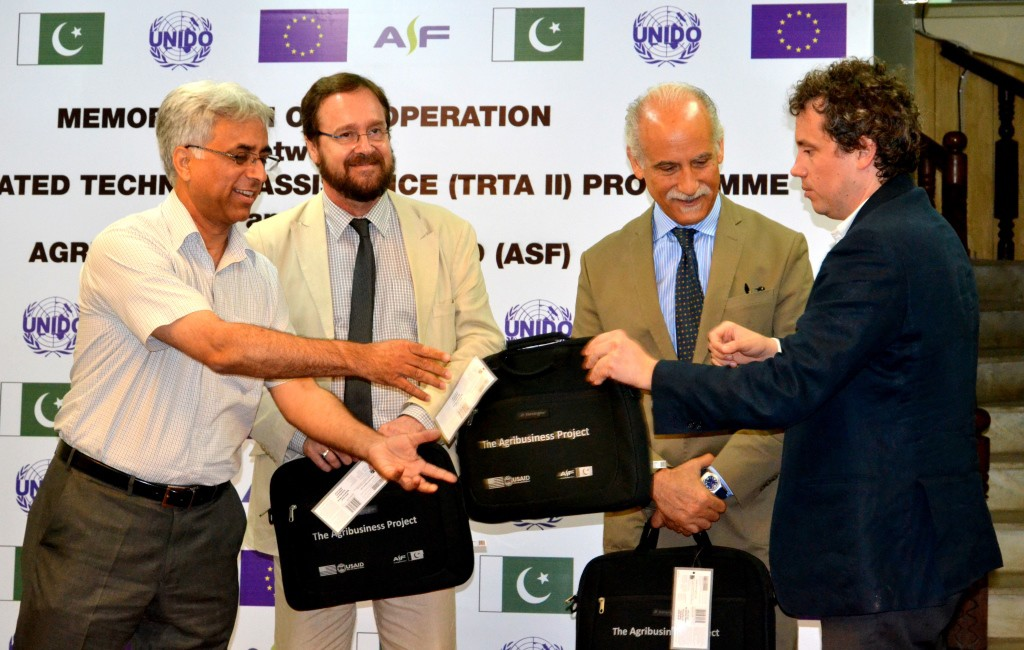 (L to R) Mr. Francois Bernard, Mr. Bruno Valanzuolo and Mr. Michele Rizzi receiving ASF Memento from Mr. Shad Muhammad