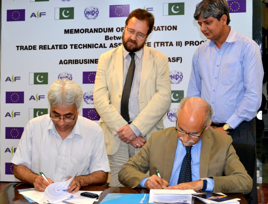 Mr Bruno Valanzuolo, Chief Technical Advisor, TRTA II and  Mr. Shad Muhammad, Chief of Party, ASF, signing the Memorandum of Cooperation