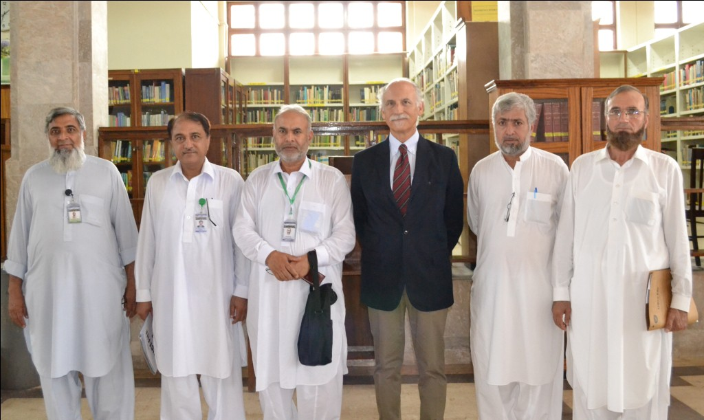 Bruno Valanzuolo with the faculty of AUP in the library