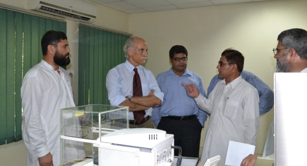 Faridullah Khan, QM, PCSIR Peshawar briefing Bruno Valanzuolo at the mass Calibration lab of PLC