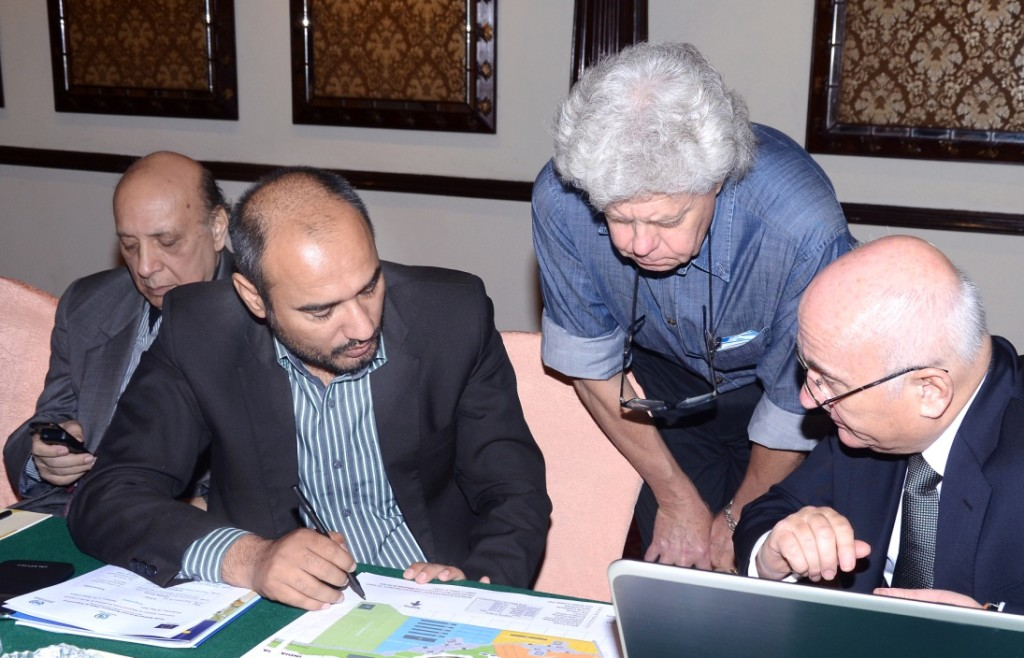 Jan Tomczyk (right) and Ian Goulding (centre) discussing the location of proposed SPS quarantine site at WAGHA Border Control drawings with ADB Consultant at the Seminar in Lahore